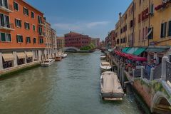VENICE, ITALY – MAY 23, 2017: Traditional narrow canal street with gondolas and old houses in Venice, Italy. Stock Photo