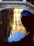 VENICE, ITALY. Bridge in Venice  with reflection of sun lighted houses Royalty Free Stock Photos