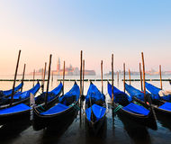 Venice, Italy. Gondolas in Venice, Italy at sunrise. San Giorgio Maggiore in the background Royalty Free Stock Images