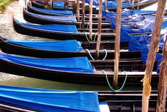 Venice, Italy. Moored covered gondolas in Venice, Italy Royalty Free Stock Photos