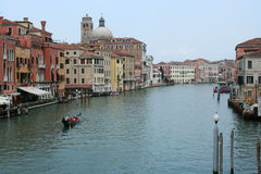 Venice, Italy. Looking down the canal and harbor with a gondola in the canal Royalty Free Stock Photos