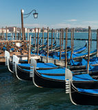 Venice, Italy. Amazing views of the Grand canal in the morning. Gondolas at the pier. Royalty Free Stock Photography