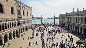 Aerial view of the iconic St. Mark`s Square, Venice, Italy. VENICE, ITALY - APRIL 29: Aerial view of tourists visiting the iconic Piazza San Marco St. Mark`s stock video footage