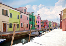 VENICE, ITALY, on APRIL 13, 2015. Burano island, multi-colored houses of locals. Cafe on the bank of the channel. Burano the islan Stock Photo