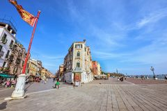 Daylight view to historic architecture buildings and people walk. VENICE, ITALY - APRIL 02, 2017: Daylight view to historic architecture buildings and people Royalty Free Stock Photography
