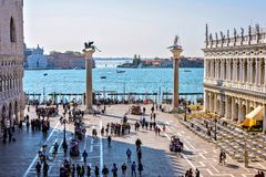 Daylight view to San Marco square famous places. VENICE, ITALY - APRIL 03, 2017: Daylight view to Marciana Library, Doge`s Palace facades and Columns of San Stock Photo