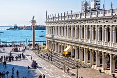 Daylight view to Marciana Library and square. VENICE, ITALY - APRIL 03, 2017: Daylight view to Marciana Library facade and Columns of San Marco and San Todaro Royalty Free Stock Photos