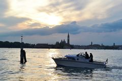 Beautiful sunset over the Venice lagoon, cloudscape, cityscape of the island of San Giorgio Maggiore. royalty free stock image