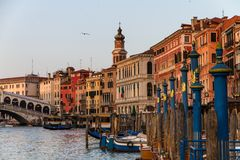 VENICE, Italy - April 25, 2013: Scenic View of Gran Canal with Rialto Bridge at Sunset. Beautiful Panorama with warm Colors stock photos