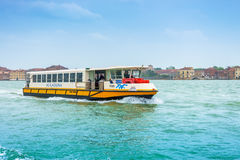 Venice, Italy - April 27, 2017: Tourist boat on Grand Canal, whi Stock Photos