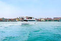 Venice, Italy - April 27, 2017: Tourist boat on Grand Canal, whi Royalty Free Stock Photos