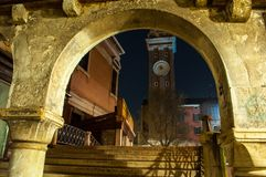 Venice Italy arch over stair bridge at night. Clock tower in background with tree.  Long exposure Stock Photography