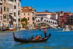 Free VENICE, ITALY - AUGUST 22, 2016: Tourists Ride In Gondola Near Rialto Bridge On August 22, 2016 In Venice Italy Stock Photo - 138422000