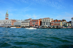 VENICE, ITALY - AUGUST 9, 2016: amazing view of Venice from the Lagoon with St Mark`s bell tower on the background, Venice, Italy Royalty Free Stock Images