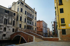 Venice, Italy  August 26, 2010: Colored facades, narrow canal an Royalty Free Stock Photography