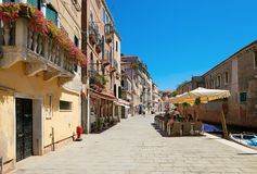 Venice, Italy - August 14, 2017: The cozy cafes of Venice. Venice, Italy - August 14, 2017 The cozy cafes of Venice Royalty Free Stock Photo