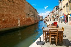 Venice, Italy - August 14, 2017: The cozy cafes of Venice. Venice, Italy - August 14, 2017 The cozy cafes of Venice Royalty Free Stock Photography