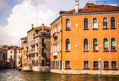 VENICE, ITALY - AUGUST 19, 2016: Famous architectural monuments and colorful facades of old medieval buildings close-up. On August 19, 2016 in Venice, Italy Stock Image