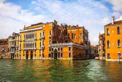 VENICE, ITALY - AUGUST 19, 2016: Famous architectural monuments and colorful facades of old medieval buildings close-up. On August 19, 2016 in Venice, Italy Stock Photography