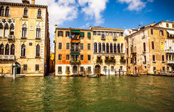 VENICE, ITALY - AUGUST 19, 2016: Famous architectural monuments and colorful facades of old medieval buildings close-up. On August 19, 2016 in Venice, Italy Stock Images