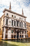 VENICE, ITALY - AUGUST 19, 2016: Famous architectural monuments and colorful facades of old medieval buildings close-up. On August 19, 2016 in Venice, Italy Stock Photos