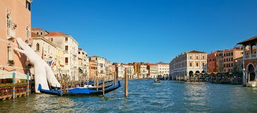 Venice, Italy - August 14, 2017: Giant hands up from the water of the Grand Canal to support the building. This powerful report on royalty free stock photo