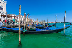 Venice, Italy - August 31, 2013. Gondola docked at the pier in V Royalty Free Stock Photography