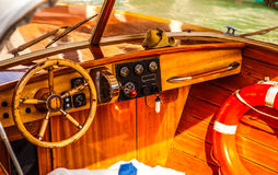 VENICE, ITALY - AUGUST 19, 2016: High-speed passenger retro style boat on the Venetian channels on August 19, 2016 in Venice Royalty Free Stock Photography