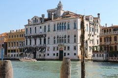 People in pleasure boat on canal of Venice, Italy. Venice, Italy - August 13, 2016: People in pleasure boat on canal of Venice Stock Image