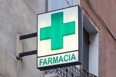 Pharmacy, farmacia sign with green cross in Italy