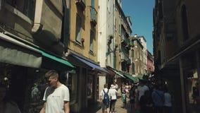 Tourists walking in old Venezia city sightseeing landmarks stock video footage