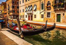 VENICE, ITALY - AUGUST 17, 2016: Traditional gondolas on narrow canal close-up on August 17, 2016 in Venice, Italy. Royalty Free Stock Photo