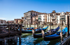 VENICE, ITALY - AUGUST 17, 2016: Traditional gondolas on narrow canal close-up on August 17, 2016 in Venice, Italy. Royalty Free Stock Images