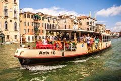 VENICE, ITALY - AUGUST 17, 2016: Vaporetto (passanger boat) at Grand Canal in Venice on August 17, 2016 in Venice, Italy Stock Photos