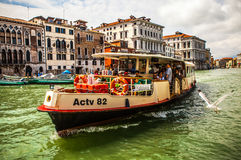 VENICE, ITALY - AUGUST 17, 2016: Vaporetto (passanger boat) at Grand Canal in Venice on August 17, 2016 in Venice, Italy Royalty Free Stock Images
