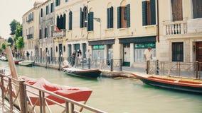 VENICE, ITALY - AUGUST 8, 2017. Venetian canal pedestrian embankment Royalty Free Stock Photo