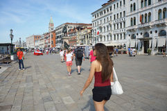 VENICE, ITALY - AUGUST 9, 2016: Venice promenade with tourists in sunny day, Venice, Italy.  Stock Image