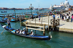 VENICE, ITALY - AUGUST 9, 2016: Venice promenade with tourists in sunny day, Venice, Italy.  Royalty Free Stock Photography