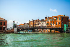 VENICE, ITALY - AUGUST 20, 2016: View on the cityscape of Grand Canal and islands of Venetian lagoon on August 20, 2016 in Venice. Italy Stock Images