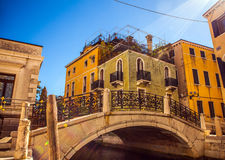 VENICE, ITALY - AUGUST 21, 2016: View on the cityscape and lovely bridge on the canal of Venice on August 21, 2016 in Venice Royalty Free Stock Images