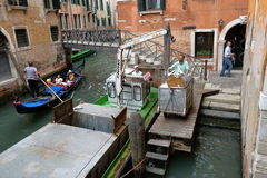 Venice, Italy. Boat with hydraulic arm for garbage collection Royalty Free Stock Photography