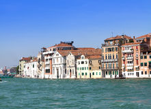 Venice. Italy. Bright ancient buildings ashore Canal Grande Royalty Free Stock Photo