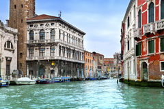 Venice. Italy. Bright ancient buildings ashore Canal Grande Royalty Free Stock Photography