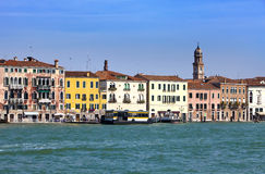 Venice. Italy. Bright ancient houses lengthways Canal Grande Royalty Free Stock Photography