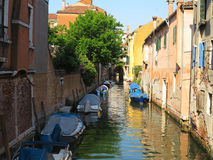 20.06.2017, Venice, Italy: Canal with boats and colorful facades Stock Images