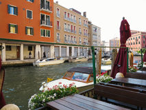 20.06.2017, Venice, Italy: Canal with boats and colorful facades Stock Image