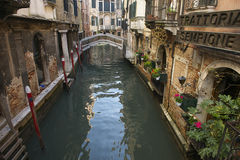 Venice Italy Canal with Bridge and Trattoria Stock Photo