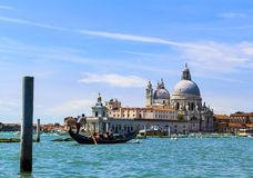 Venice Italy Grande canal, gondola and architecture.Basilica di Santa Maria della Salute. Venice waterways with gondola and other boats.Lovely architecture stock photos