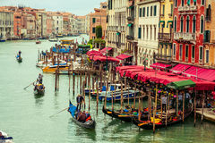 Venice, Italy. Canal Grande with some gondolas and boats floating on water. Venice is one of the most visited place by tourists Stock Photography