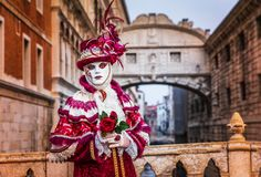 Venice, Italy. Carnival of Venice, beautiful mask at the Bridge of Sighs royalty free stock photo